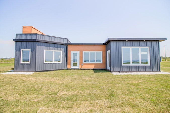 The Ultimate recycling project in Nova Scotia: Meteghan River house built with around 612,000 recycled plastic bottles